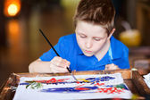 Boy painting a batik — Stock Photo