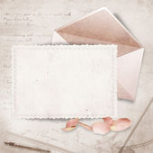 Beautiful card with envelope and rose petals — Stock Photo