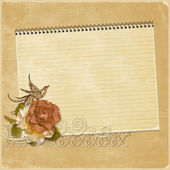 Vintage background with a notebook and a rose — Stock Photo