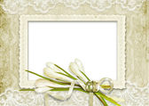 Vintage frame with snowdrops on the lace background — Stock Photo