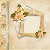 Frame with roses on vintage lace background — Stock Photo