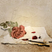 Vintage background with rose and old cards — Stock Photo