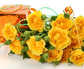 Yellow roses and gift — Stock Photo
