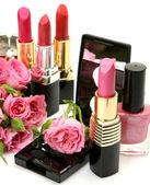 Decorative cosmetics and roses — Stock Photo