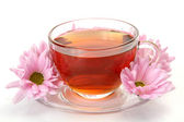 Tea and pink flowers — Stock Photo