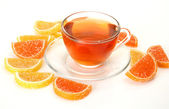 Tea and fruit candy — Stock Photo