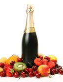 Ripe fruit and champagne — Stock Photo