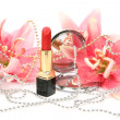 Decorative cosmetics and lilies — Stock Photo