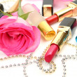 Fine rose and lipstick — Stock Photo