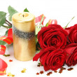 Bouquet of roses and candle — Stock Photo