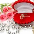Stock Photo: Fine roses and gold ring
