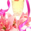Pink lilies and champagne — Stock Photo #9783404