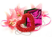 Pink lily and gift — Stock Photo