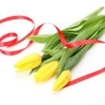 Yellow tulips and tape — Stock Photo #9792301