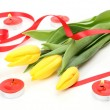Yellow tulips and tape — Stock Photo