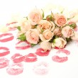 Roses and prints of lips — Stockfoto