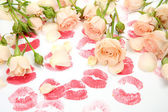 Roses and prints of lips — Stock Photo