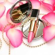 Stock Photo: Decorative cosmetics and petals of roses