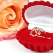 Stock Photo: Rose and gold ring