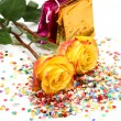 Yellow roses and packages — Stock Photo