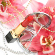 Decorative cosmetics and flowers — Stok fotoğraf