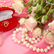 Fine roses and jewelry — Stock Photo