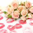 Fine roses and pink lips — Stock Photo