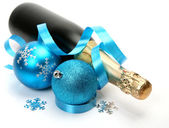 Champagne and New Year's ornaments — Stock Photo