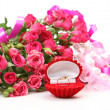 Stock Photo: Pink roses and ring
