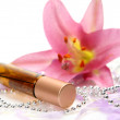Pink lily and bottle — Stock Photo