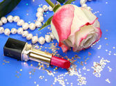 Lipstick and rose — Stockfoto