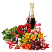 Champagne and bouquet of roses — Stock Photo