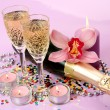Stock Photo: Champagne and flowers