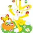 Easter Bunny juggles painted eggs — Stock Vector #8856926