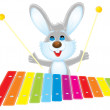 Rabbit plays a xylophone — Stock Photo