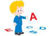 Schoolboy in English class — Stock Vector