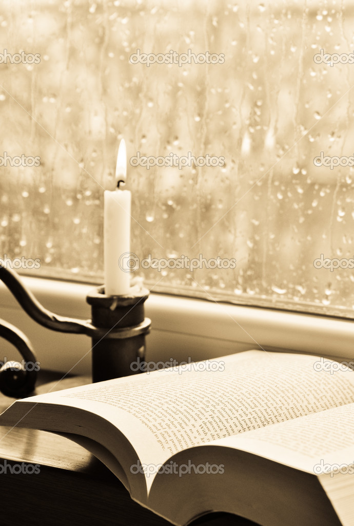 A book and a candle on a rainy day — Lizenzfreies Foto #10106571