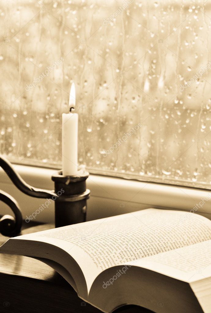 A book and a candle on a rainy day — Stok fotoğraf #10106571