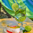 Breakfast outdoors: delicious fruit cake and cold mojito — Stock Photo