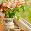 Ceramic cup with coffee and bouquet of alstroemeria — Stock Photo