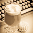 Latte with marshmallows and type-writer - Stock Photo