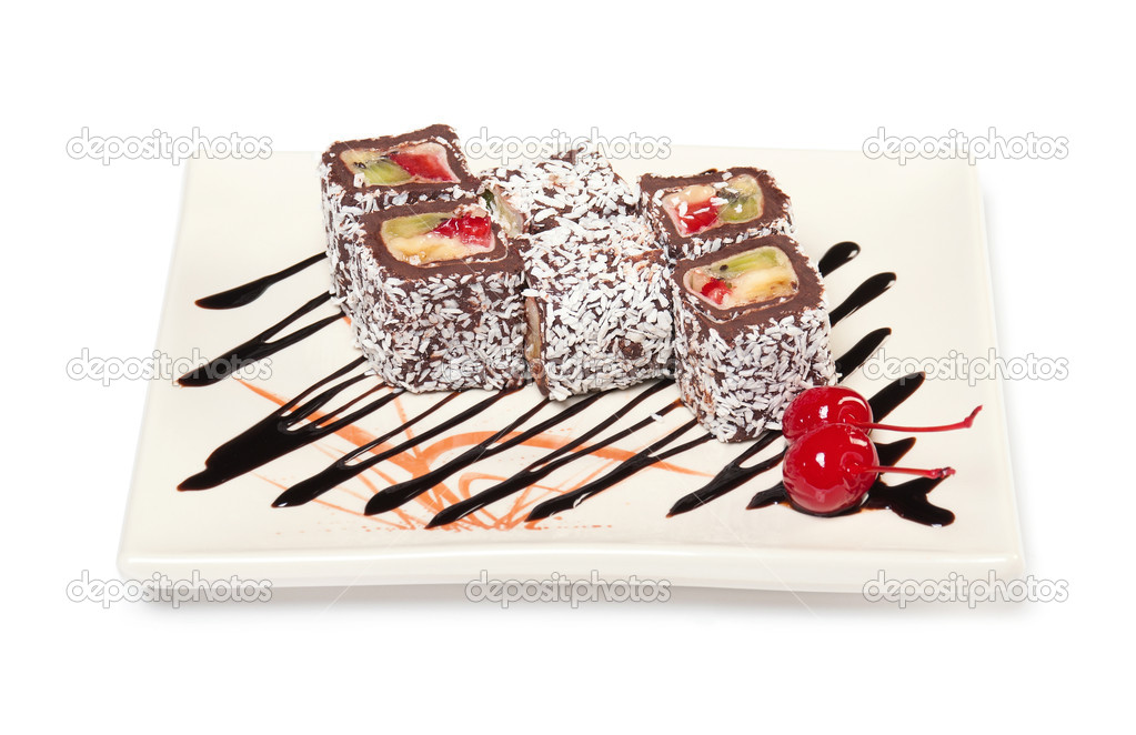 Chocolate roll with fruit filling sprinkle coconut on a plate with sauce and a cherry. The traditions of cuisine in Japan  Stock Photo #9107122