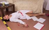 Crime scene simulation. Nurse lying on the floor — Stock Photo