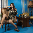 Lady in a blue colors boudoir - ストック写真