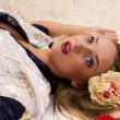 Pretty girl lying on the floor - Stock Photo