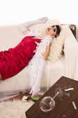 Poisoned woman lying on the sofa — Stock Photo