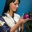 Pretty woman decorate a Christmas tree — Stock Photo