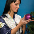 Pretty woman decorate a Christmas tree - Stock Photo