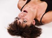 Beautiful young woman choking — Stock Photo