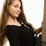 Happy teenager girl playing guitar — Stock Photo